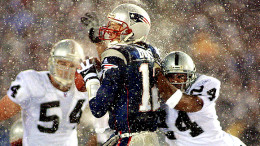 "This forced fumble by Charles Woodson ultimately did not stand, as the ""Tuck Rule"" essentially began a Patriots dynasty. (Photo credit: Matt Campbell/Getty Images)"
