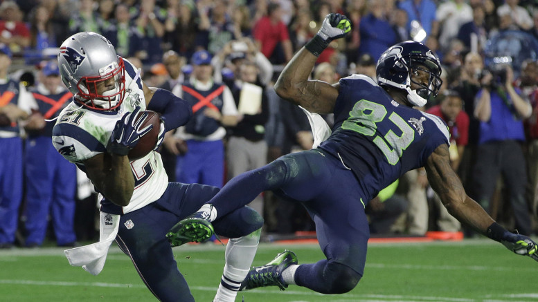 Malcolm Butler made a tremendous interception to seal Super Bowl XLIX, but fans will forever be left wondering what the Seahawks were thinking with their play call. (Photo credit: Kathy Willens/AP)