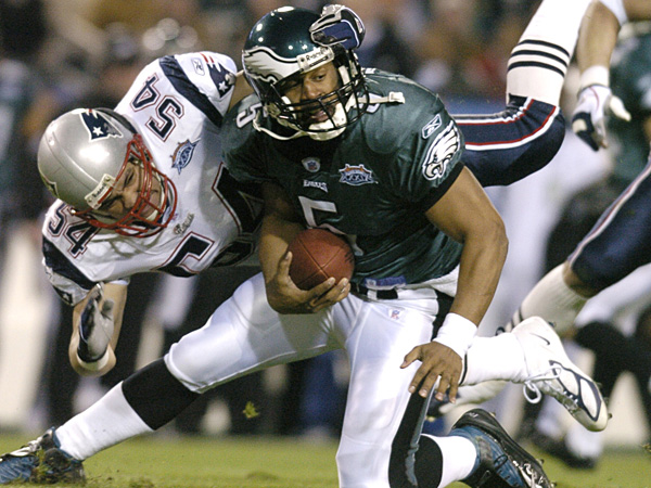 Tedy Bruschi brings down Donovan McNabb in Super Bowl XXXIX. Ultimately, Andy Reid's poor clock management brought down the Eagles' chances of a comeback.