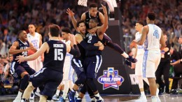 Kris Jenkins (2) is mobbed by his Villanova teammates after hitting a 40-footer to seal the national championship.