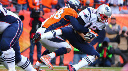Jan 24, 2016; Denver, CO, USA; New England Patriots quarterback Tom Brady (12) is sacked by Denver Broncos outside linebacker Von Miller (58) in the second half in the AFC Championship football game at Sports Authority Field at Mile High. Mandatory Credit: Mark J. Rebilas-USA TODAY Sports