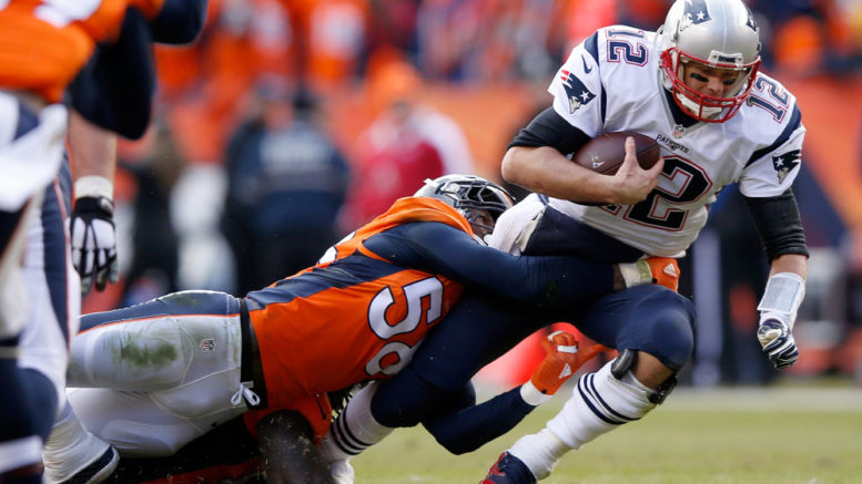 Von Miller and the Broncos defense harassed Tom Brady throughout last year's AFC championship game, but can they do it again on Sunday and pull the upset? Brady is 2-7 lifetime in Denver. (Photo credit: Ezra Shaw/Getty Images.)